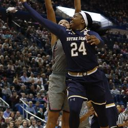 Notre Dame's Arike Ogunbowale (24) lays it in in front of UConn's Napheesa Collier (24) during the Notre Dame Fighting Irish vs UConn Huskies women's college basketball game in the Women's Jimmy V Classic at the XL Center in Hartford, CT on December 3, 2017.