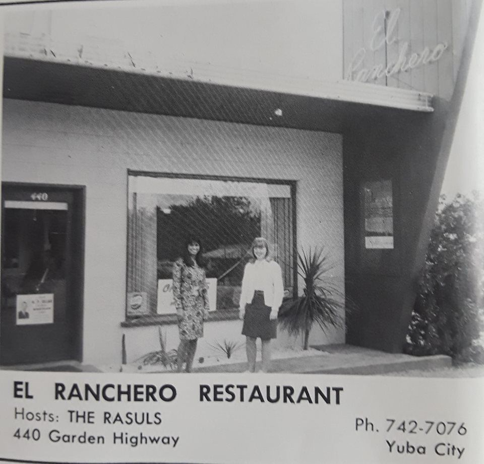 A photo of two high schoolers in front of the restaurant, El Ranchero