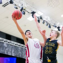 Layton Christian fast-paced offense created many fast breaks.  Lino Saez (40) shoots as the Roy's Caleb Koski (23) defends.