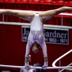 Arizona's Elena Deets competes on the bars during a meet against Utah at the Huntsman Center in Salt Lake City on Saturday, Jan. 23, 2021.