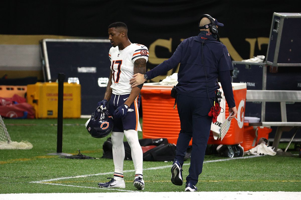Bears coach Matt Nagy talks to receiver Anthony Miller after he was ejected for punching Saints cornerback C.J. Gardner-Johnson in the third quarter of their wild-card playoff game on Jan. 10.