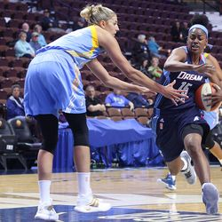Chicago Sky's Elena Delle Donne (11) tries to slow down the Dream's Tiffany Hayes (15).