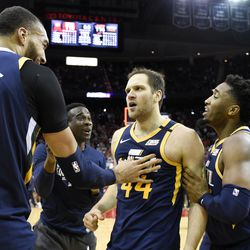 Utah Jazz forward Bojan Bogdanovic, center, celebrates after shooting the game-winning three point basket with Rudy Gobert, left, and Donovan Mitchell, right during the second half of an NBA basketball game against the Houston Rockets, Sunday, Feb. 9, 2020, in Houston.