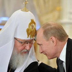 FILE - In this Wednesday, Feb. 8, 2012 file photo, Russian Prime Minister Vladimir Putin, right, speaks with Russian Orthodox Patriarch Kirill during his meeting with Russia's religious leaders in the St. Daniel Monastery in Moscow. Critics have said that the church lost its impartiality when Kirill signaled his support for Prime Minister and presidential candidate Vladimir Putin shortly before the March vote.