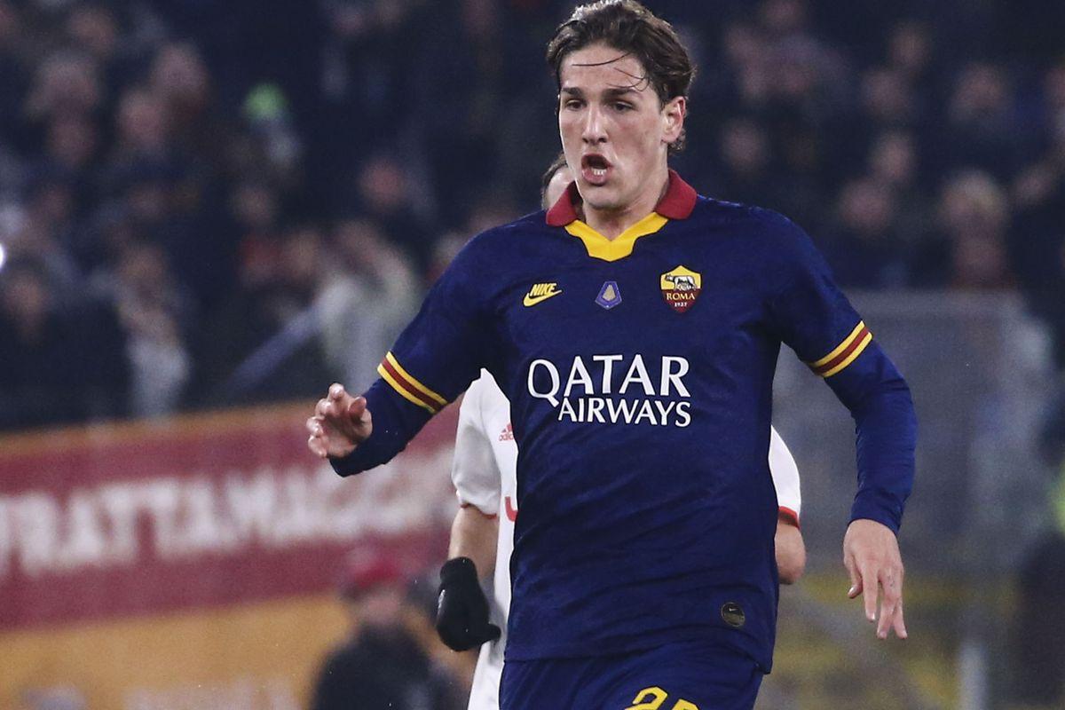 Roma's Italian midfielder Nicolo Zaniolo controls the ball...