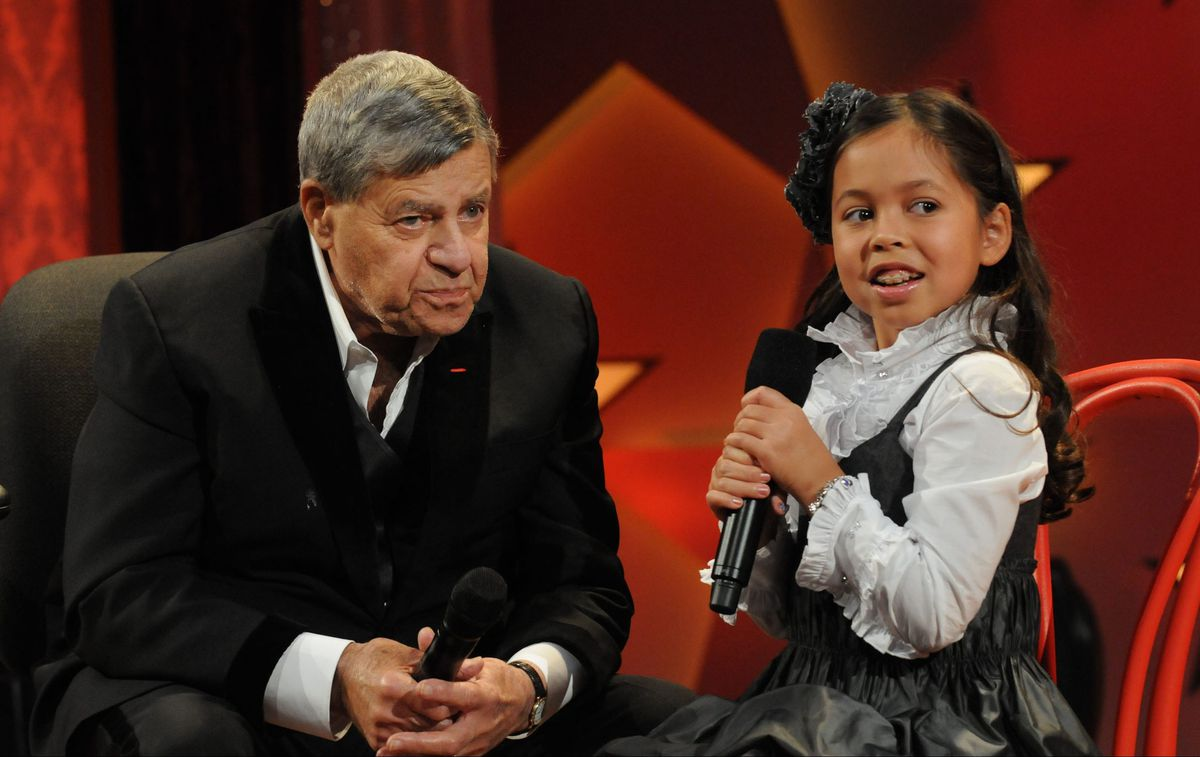Jerry Lewis chats with Muscular Dystrophy Association National Goodwill Ambassador Abbey Umali during the 2009 Labor Day Telethon. | MUSCULAR DYSTROPHY ASSOCIATION