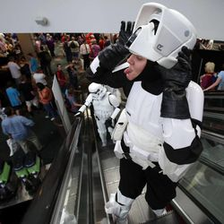 Brittanie Larsen, dressed as a stormtrooper from Star Wars, makes faces while riding the escalator at Utah's first Comic Con at the Salt Palace Convention Center in Salt Lake City on Thursday, Sept. 5, 2013.
