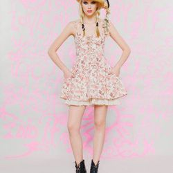 """<a href=""""http://www.betseyjohnson.com/product/index.jsp?productId=12546832"""">Floral cotton poplin</a>, $110 (was $138)"""