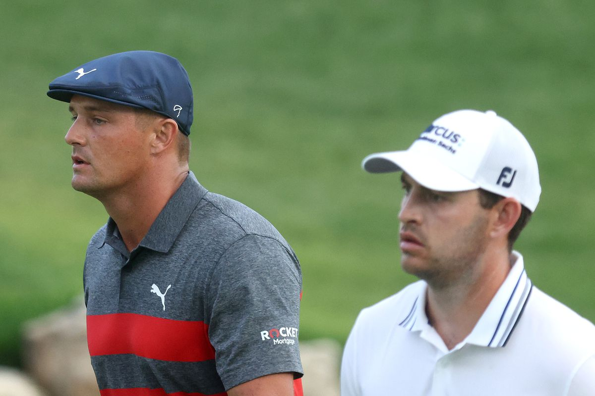 Patrick Cantlay of the United States and Bryson DeChambeau of the United States walk on the 18th hole during a playoff during the final round of the BMW Championship at Caves Valley Golf Club on August 29, 2021 in Owings Mills, Maryland.