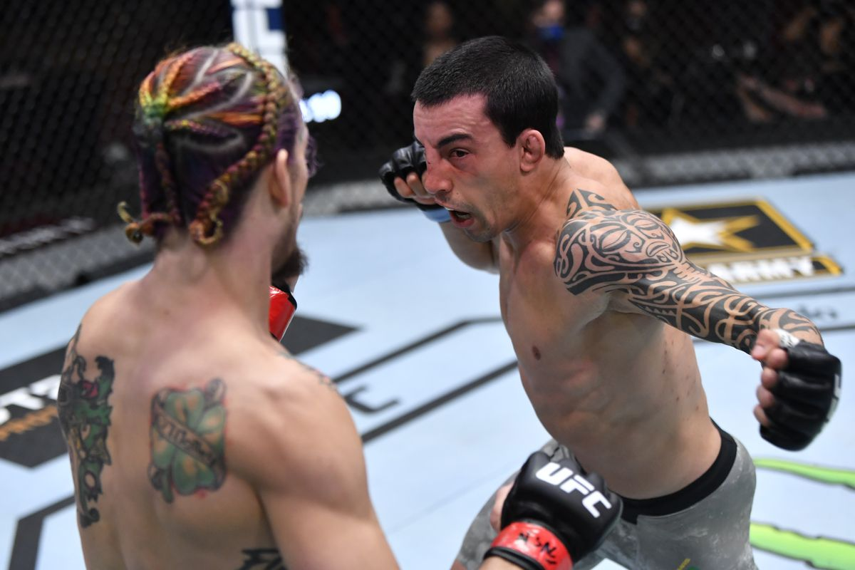 Thomas Almeida charges into the pocket against Sean O'Malley.
