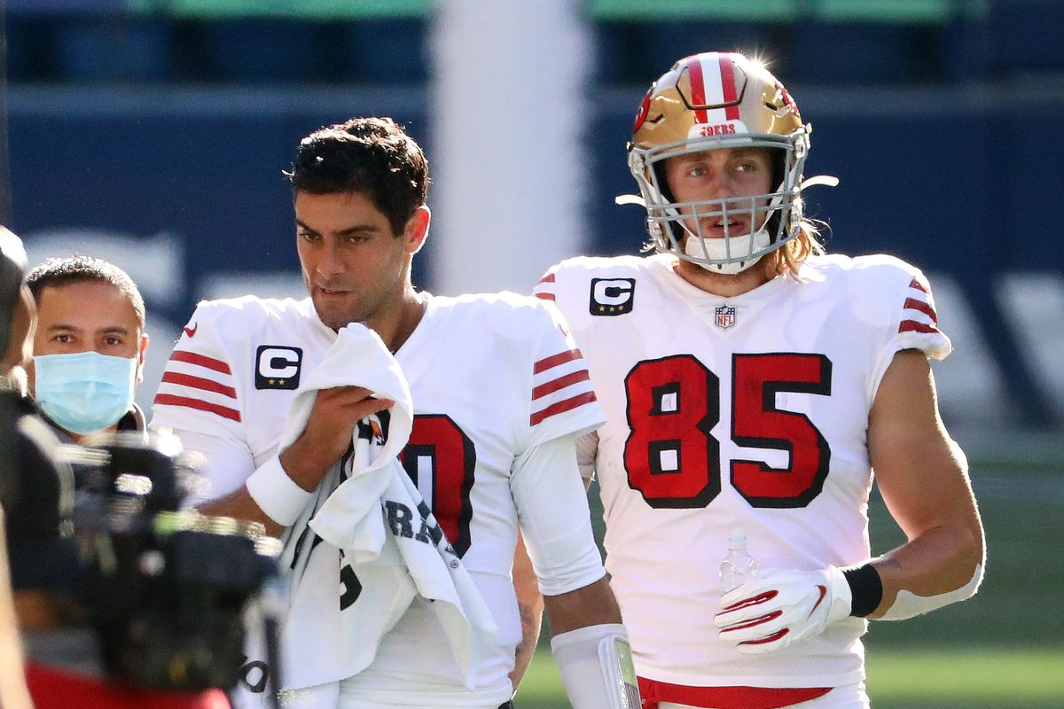 Jimmy Garoppolo #10 and George Kittle #85 of the San Francisco 49ers react in the first quarter against the Seattle Seahawks at CenturyLink Field on November 01, 2020 in Seattle, Washington.