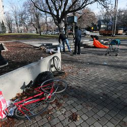 Health department officials clean up a homeless camp at Taufer Park in Salt Lake City with the help of Utah Highway Patrol troopers and Salt Lake City police officers on Tuesday, Dec. 10, 2019.