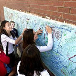 Students at Salt Lake's Bryant Intermediate School, where Elizabeth Smart was a student at the time she was abducted, sign a poster welcoming her home.