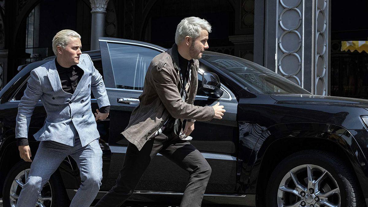 Jon Fletcher and Ronan Raferty as Gestalt run out of a car on The Rook