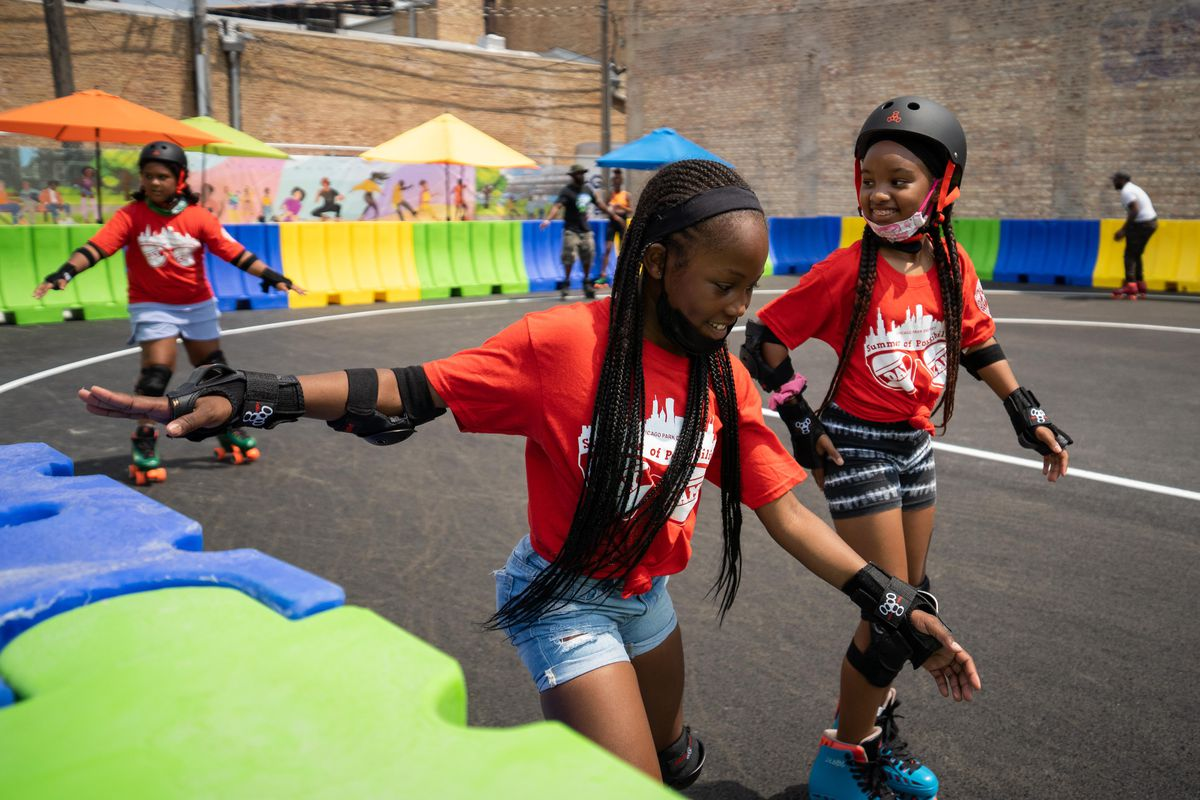Kids skate at opening day for the community plaza and outdoor roller rink at Madison Street and Pulaski Road in the West Garfield Park neighborhood on Friday, July 23, 2021.
