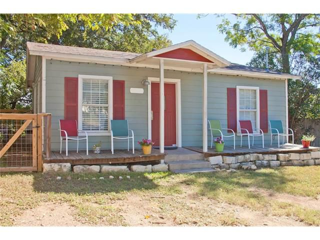 Small frame house with light blue siding and red trim