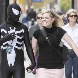 James and Carleigh, dressed as Venom and Gwen Stacy, walk toward the Salt Palace to attend Salt Lake Comic Con on Friday, April 18, 2014. A variety of concerts, conventions, races, games and other events are attracting thousands of people to Salt Lake this weekend.