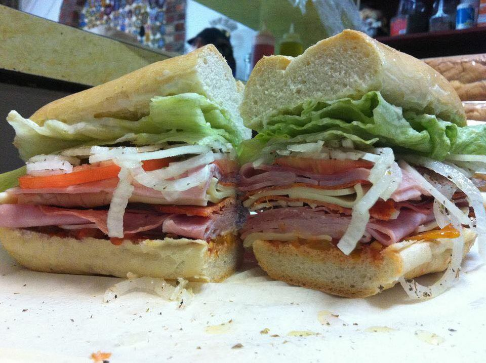 A sliced sandwich stuffed with cold cuts