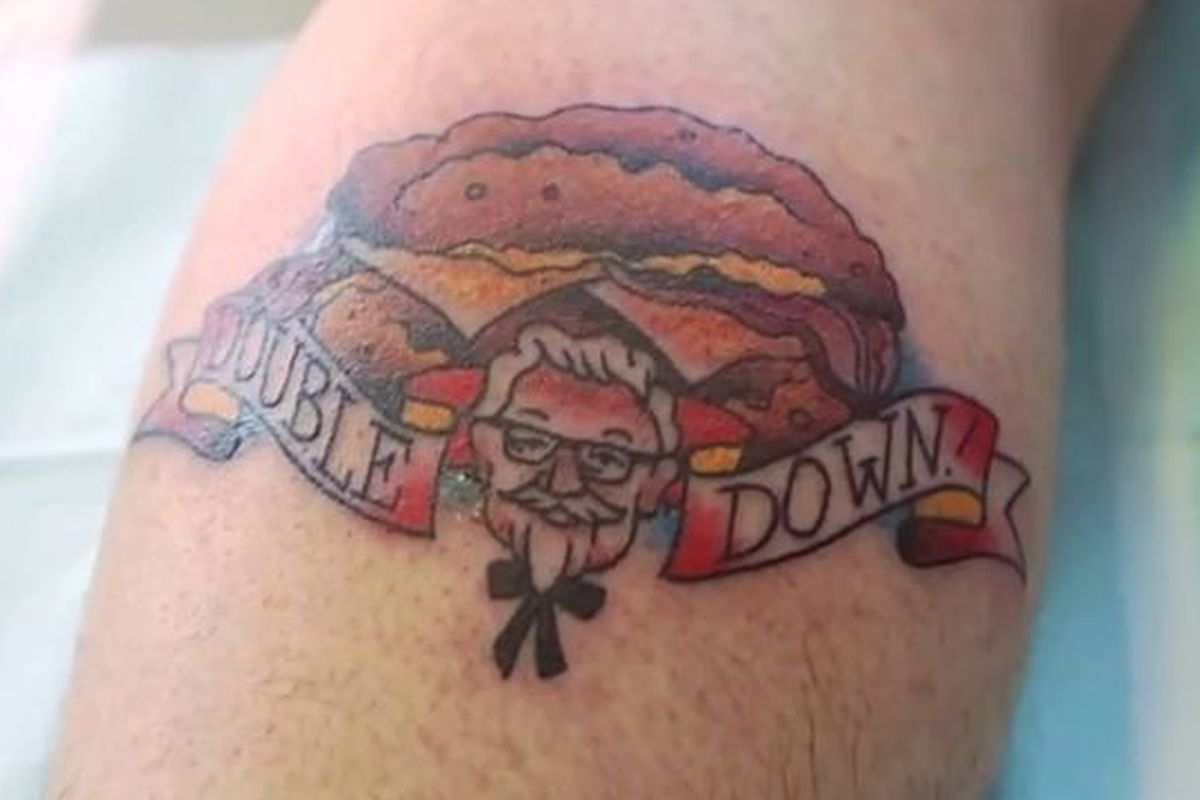29b8babaee8d6 KFC's YouTube channel triumphantly brings this video of an unidentified  (but bearded) individual getting a tattoo of the Double Down, aka the soon- to-return ...