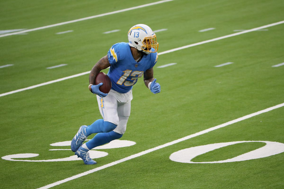 Keenan Allen #13 of the Los Angeles Chargers runs the ball against the Jacksonville Jaguars during the fourth quarter at SoFi Stadium on October 25, 2020 in Inglewood, California.
