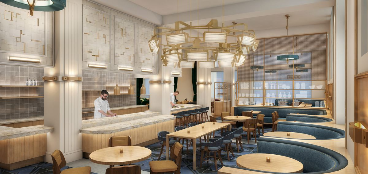 interior of restaurant with blue and gold decor and a bar