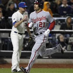 Washington Nationals' Xavier Nady (21) scores on a double by Wilson Ramos in the sixth inning as New York Mets relief pitcher Bobby Parnell, left, watches during a baseball game in New York, Tuesday, April 10, 2012.