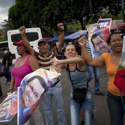 Supporters of Venezuela's President Hugo Chavez cheer on fellow supporters driving past in a campaign caravan in Caracas, Venezuela, Friday, Sept. 28, 2012. Venezuela's presidential election is scheduled for Oct. 7.