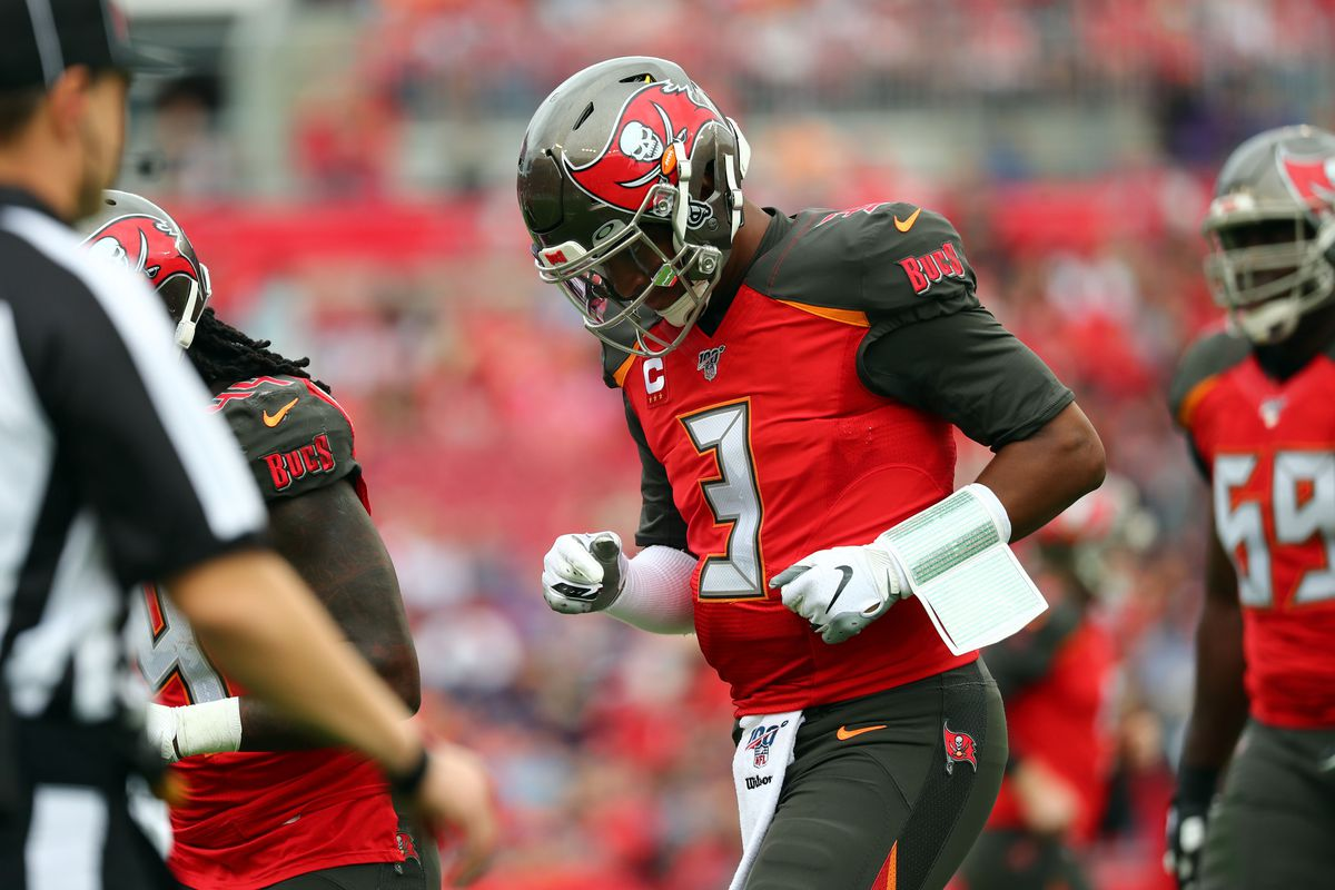 Tampa Bay Buccaneers quarterback Jameis Winston runs with his head down during the first half against the Houston Texans at Raymond James Stadium.