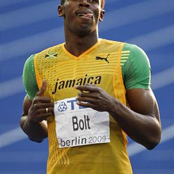 Jamaica's Usain Bolt eases over the line to win a Men's 200m semifinal during the World Athletics Championships in Berlin on Wednesday.