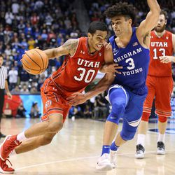 Utah Utes guard Gabe Bealer (30) drives against Brigham Young Cougars guard Elijah Bryant (3) at the Marriott Center in Provo on Saturday, Dec. 16, 2017.