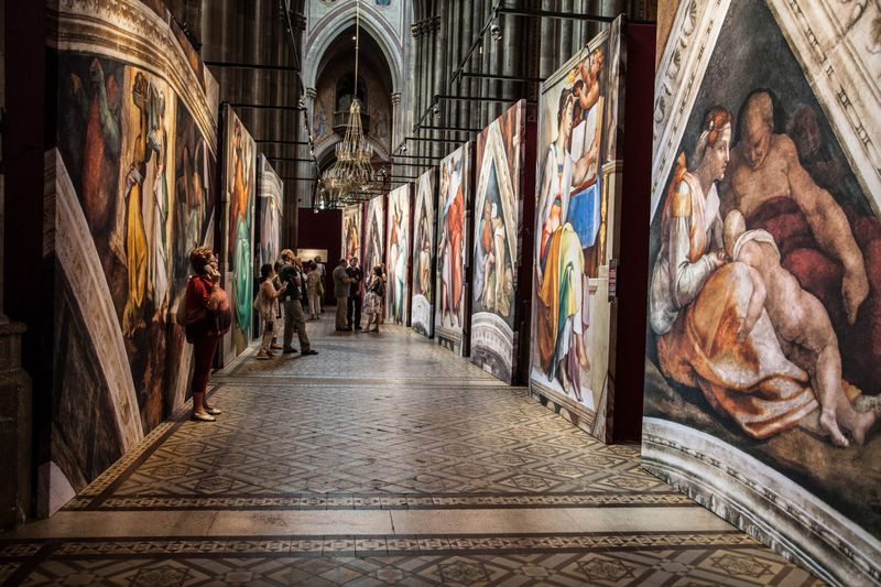 """Extensive audio tracks written by a German university scholar guide visitors throughout """"Michelangelo's Sistine Chapel: The Exhibition."""""""