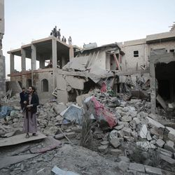A man stands on the rubble of houses destroyed by Saudi-led airstrikes in Sanaa, Yemen, Friday, Jun. 9, 2017. Three siblings and their grandmother were killed early Friday after Saudi-led coalition forces dropped munitions on three houses in the Yemeni capital, the children's father said.