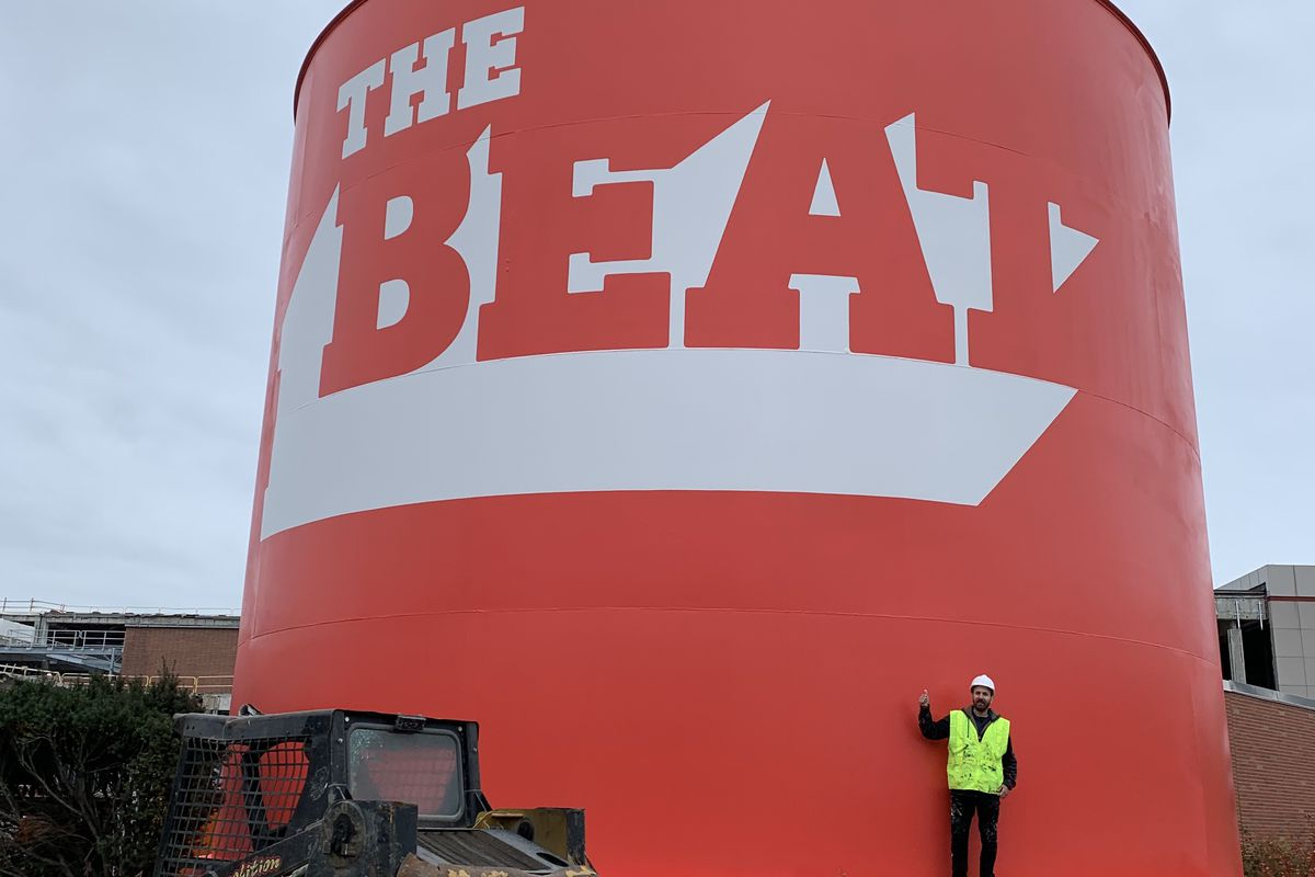 A painted sign on a water tank.