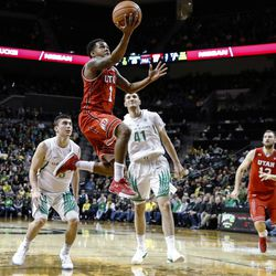Utah guard Justin Bibbins (1) drives to the basket against Oregon during an NCAA college basketball game Friday, Dec. 29, 2017, in Eugene, Ore. (AP Photo/Thomas Boyd)