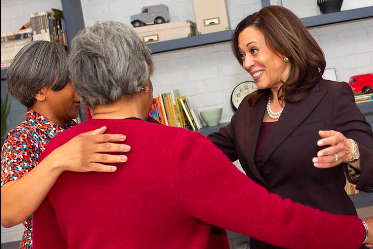 """Democratic vice presidential nominee Kamala Harris, then running for president, greets supporters, including fellow Alpha Kappa Alpha member Josephine Perry (in red), at a 2019 Chicago fundraiser. Perry is among dozens of Chicago area women, many of them AKA's, who last week launched """"Women 2 Win,"""" with the mission to phone bank and raise $1 million to support Harris."""