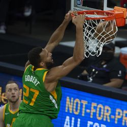 Utah Jazz center Rudy Gobert (27) dunks the ball against the Sacramento Kings during the first quarter of an NBA basketball game in Sacramento, Calif., Sunday, May 16, 2021.