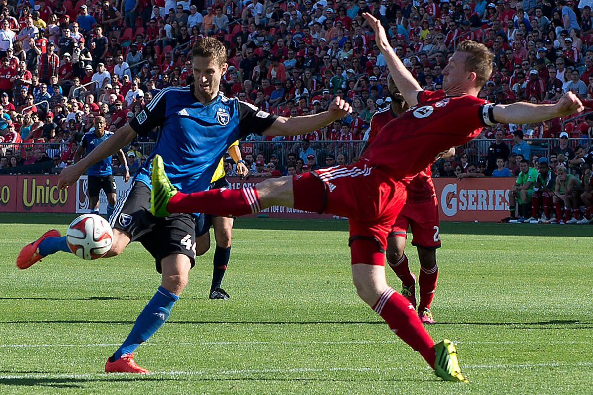 San Jose's Clarence Goodson looks to get a shot past Toronto's Steven Caldwell