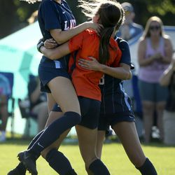 Layton's Hannah Roe, left, celebrates with goalie, Rilee Godfrey, after beating Davis in a penalty kick shootout at Layton High School on Thursday, Aug. 27, 2020.