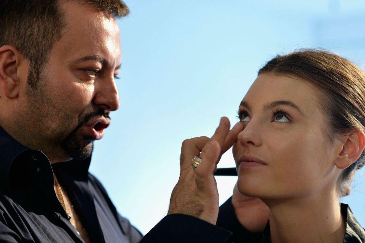 Napoleon Perdis works his magic during Australia Fashion Week. Photo via Getty Images.