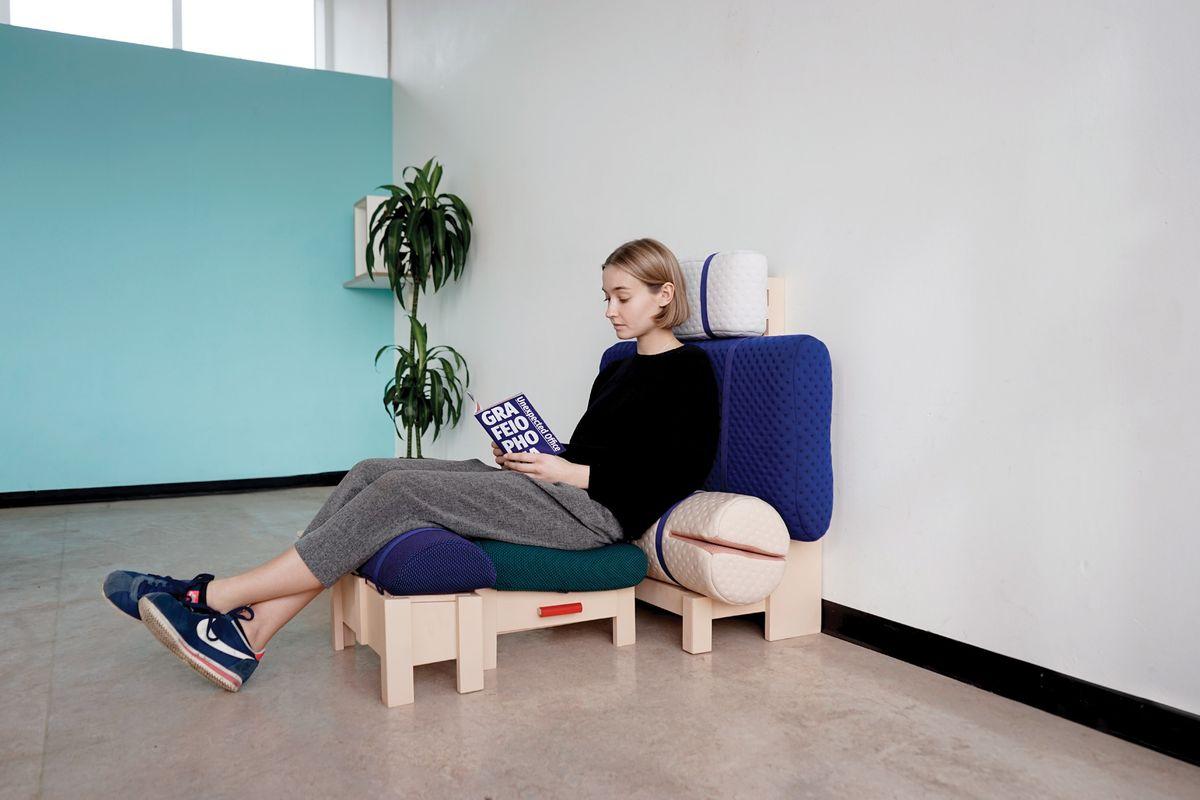 Woman sitting on cushions