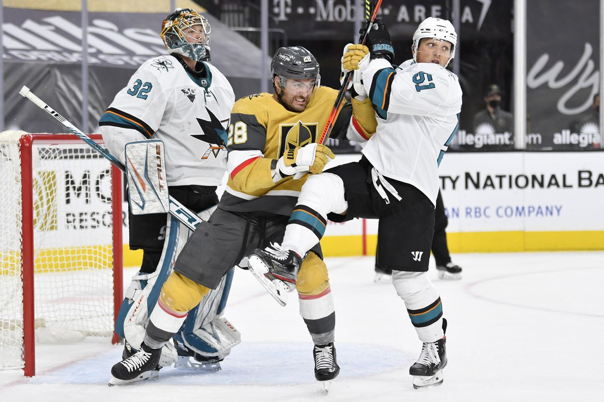 William Carrier #28 of the Vegas Golden Knights battles Radim Simek #51 of the San Jose Sharks in front of the net during the third period of a game at T-Mobile Arena on April 21, 2021 in Las Vegas, Nevada.