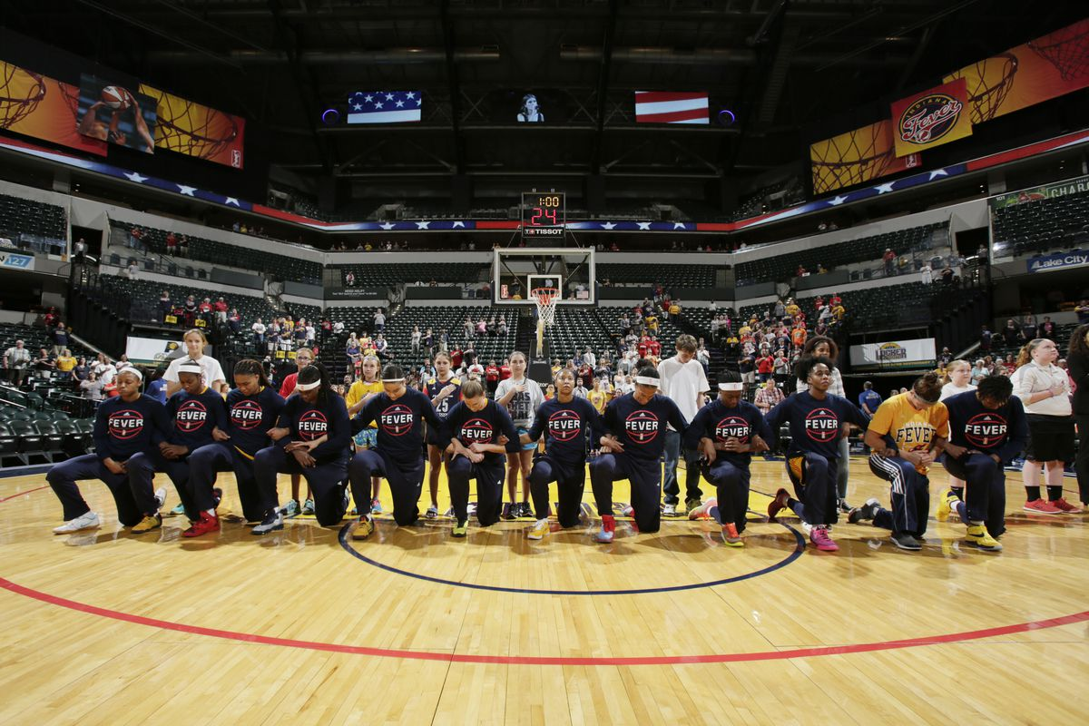 The Indiana Fever kneel during the national anthem before the game against the Phoenix Mercury during Round One of the 2016 WNBA Playoffs on September 21, 2016