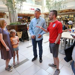Libertarian presidential candidate Gov. Gary Johnson talks with Zach Bloxham, his wife Kayla and their daughter Kinley, at the the food court at City Creek Center as he and running mate Gov. Bill Weld visit Salt Lake City for a speech at the University of Utah on Saturday, Aug. 6, 2016.