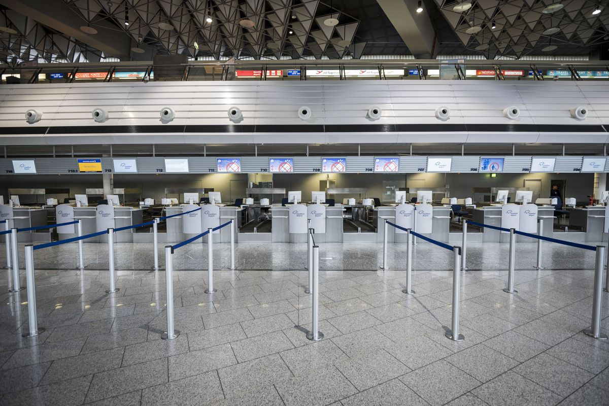 A deserted ticketing area in an airport.