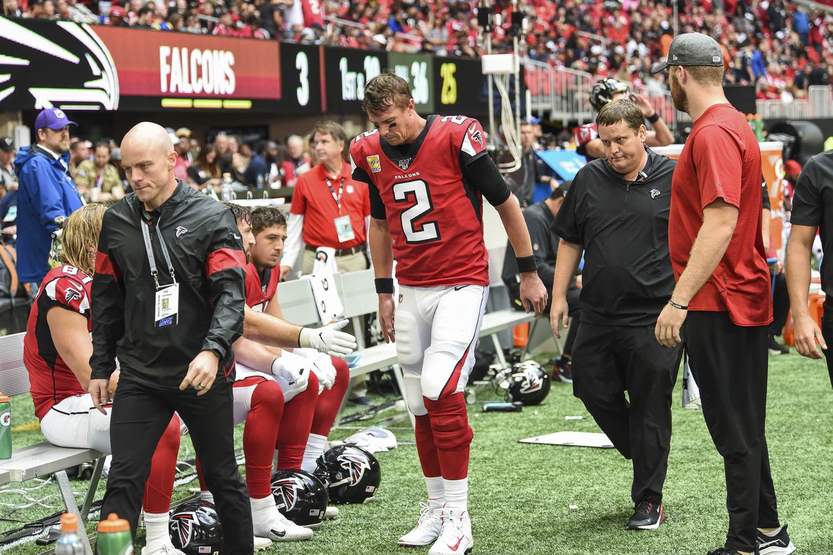 Atlanta Falcons quarterback Matt Ryan is assisted to the medical tent to be checked after being injured against theLos Angeles Rams during the second half at Mercedes-Benz Stadium.