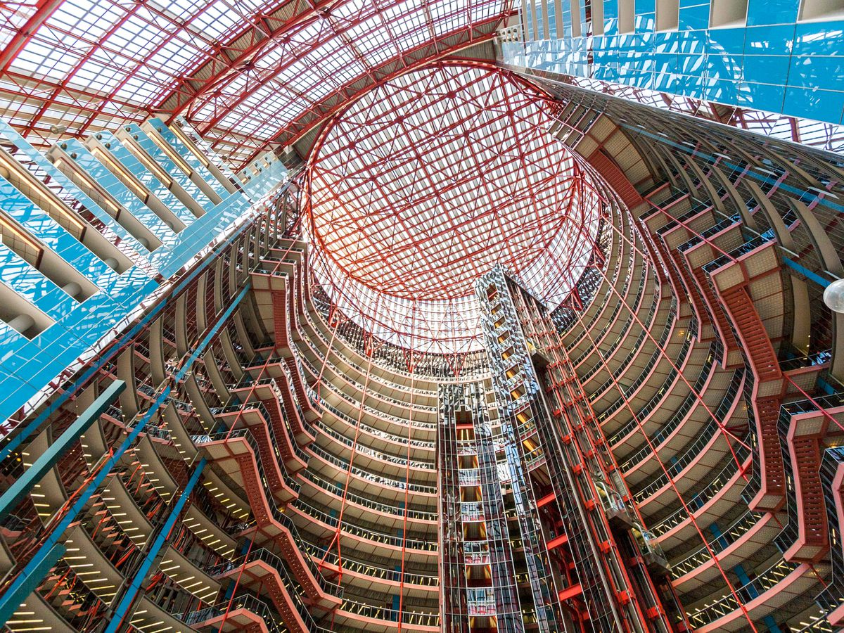 The interior of the James R. Thompson Center. The walls have colorful steel support beams and glass.