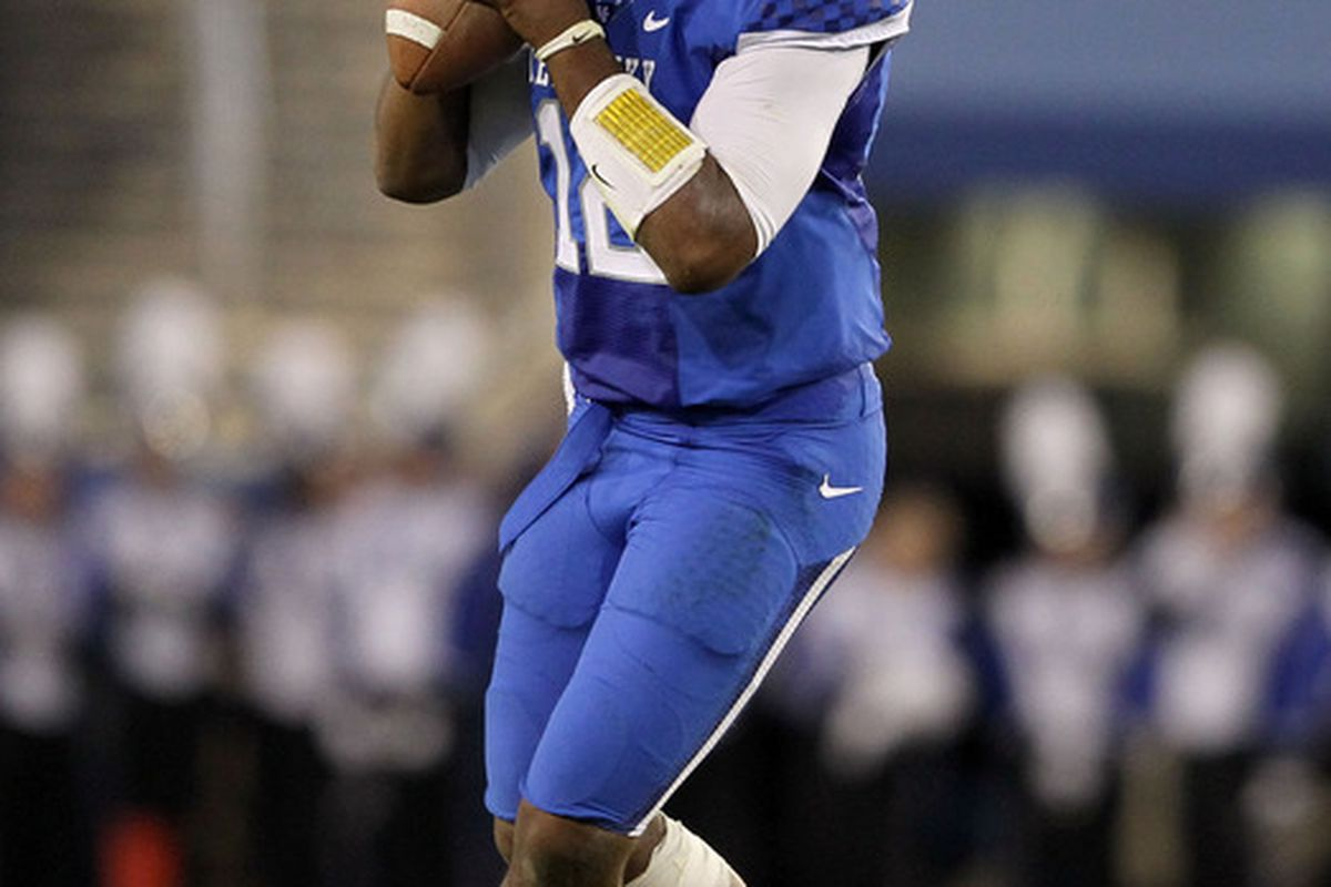 LEXINGTON, KY - SEPTEMBER 17:  Morgan Newton #12 of the Kentucky Wildcats throws the ball during the game against the Louisville Cardinals at Commonwealth Stadium on September 17, 2011 in Lexington, Kentucky.  (Photo by Andy Lyons/Getty Images)