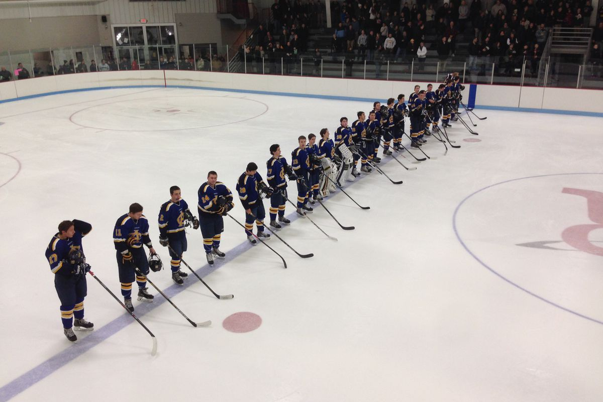 Arlington Catholic players line up for a game at Reading's Burbank Arena earlier in the season.