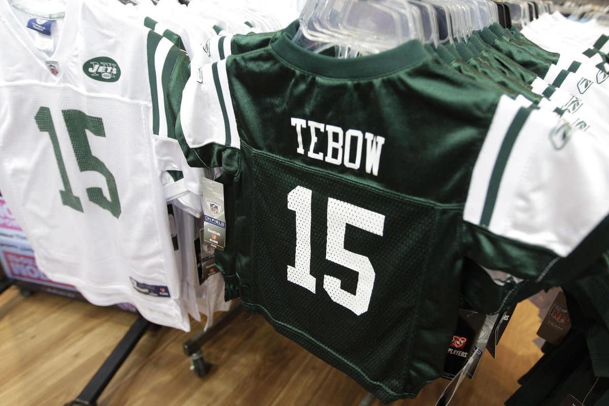In this March 26, 2012, file photo, Reebok brand New York Jets football jerseys with the name and number of their new quarterback Tim Tebow hang on display at a Modell's store in New York.