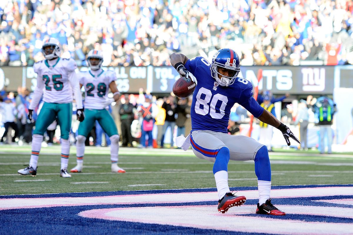 Victor Cruz of the New York Giants celebrates after scoring a touchdown against the Miami Dolphins at MetLife Stadium on October 30, 2011 in East Rutherford, New Jersey.  (Photo by Patrick McDermott/Getty Images)